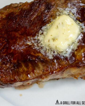 pat of butter melting on a steak