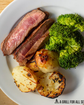 sliced steak with broccoli and potatos