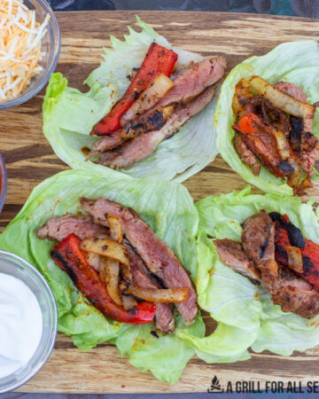 wood board with lettuce wrap fajitas and topping