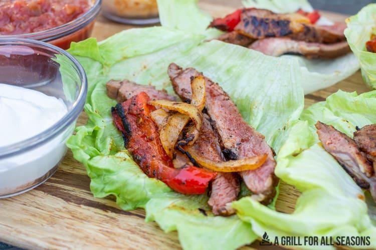 steak fajita lettuce wrap on wood board