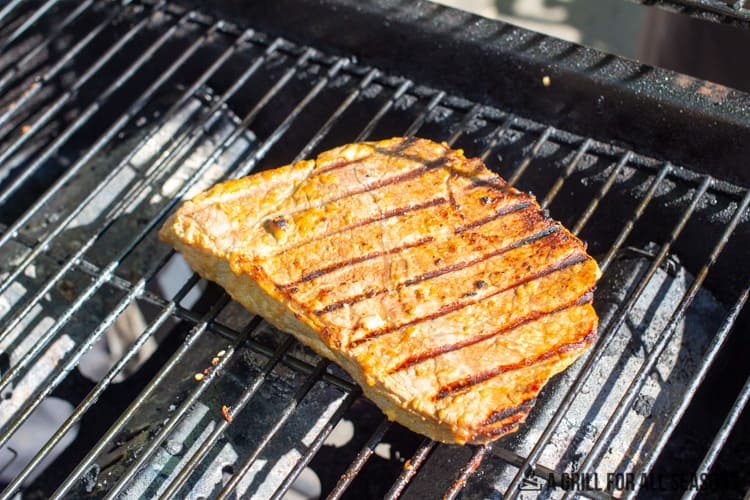 cooked steak on grill with lines