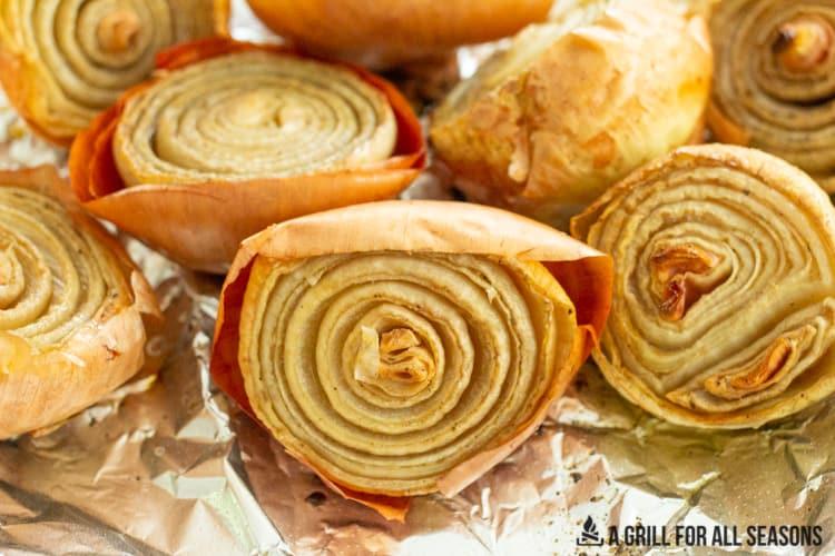 onion halves on foil