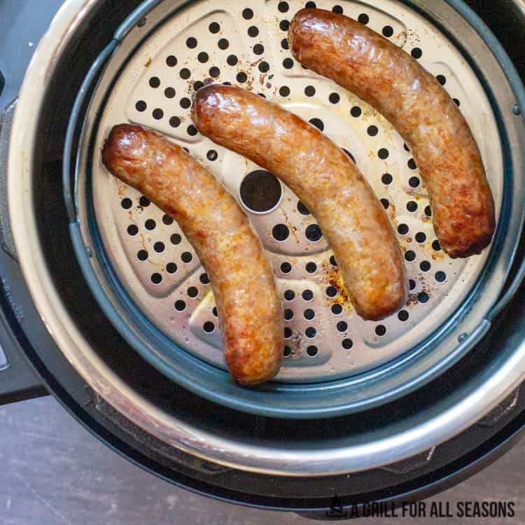 cooked Italian pork sausages in metal basket