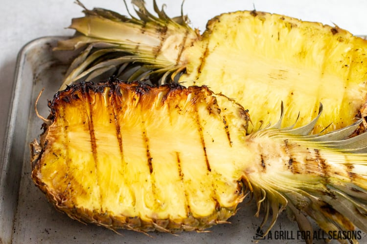halved pineapples on a tray