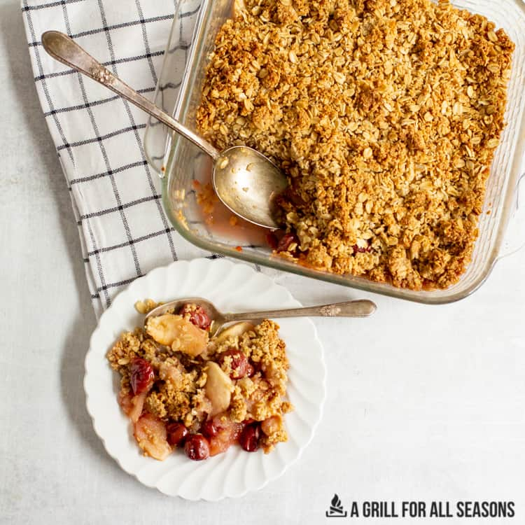 baking dish with Apple Cherry Crumble and some on a small plate