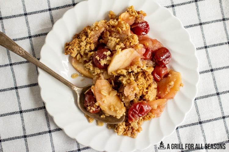 overhead shot of a serving of the Apple and Cherry Crumble on a plate