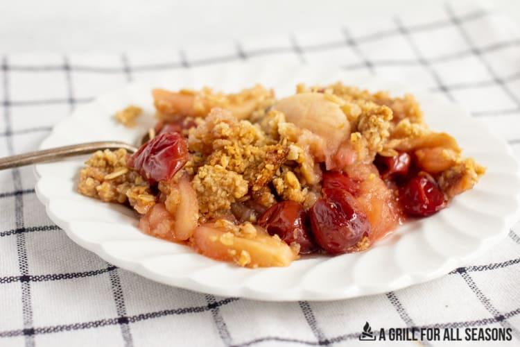 apple cherry crisp on a small plate