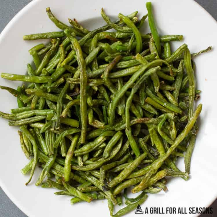 plate of air fryer frozen green beans cooked crisp