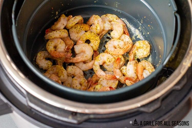 cooked air fryer frozen shrimp in the basket