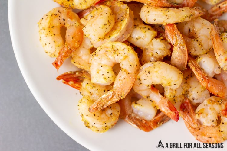 close up of air fried shrimp on a plate