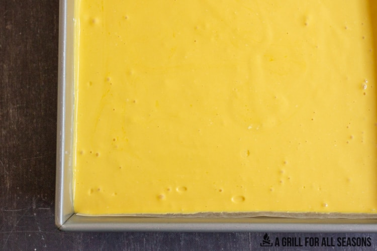 mango cheesecake filling in the pan