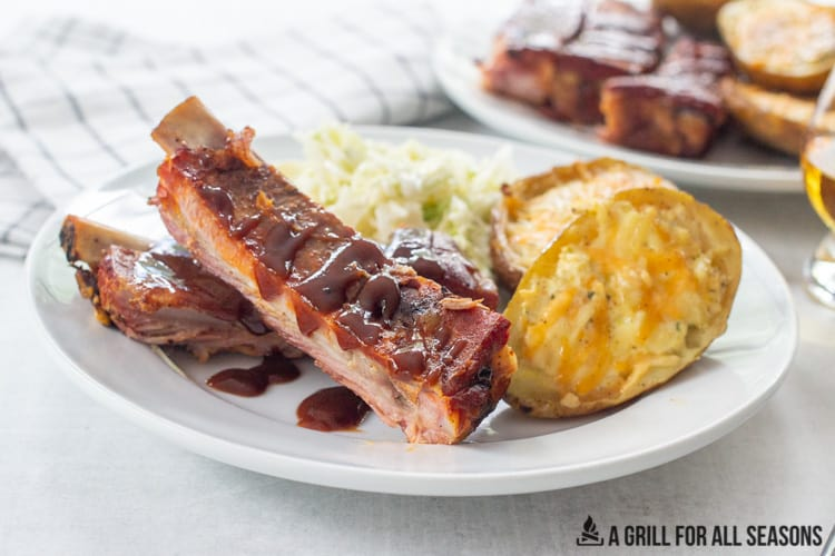 dinner plate with pellet grill ribs and side dishes