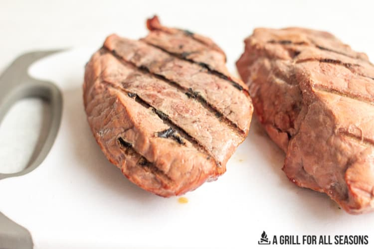 two smoked sirloin steaks with grilled lines