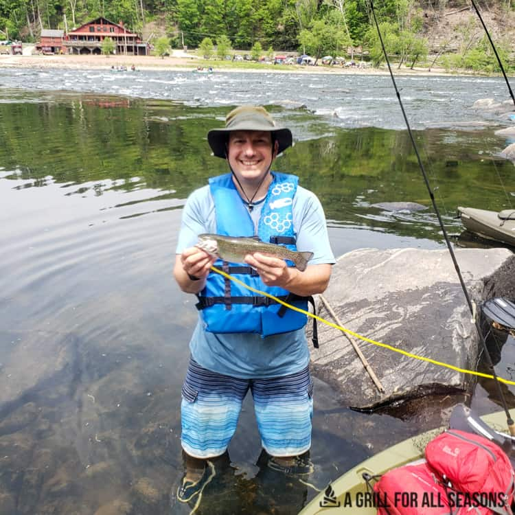 Paul holding up his freshly caught trout in the Delaware River, Barryville NY.
