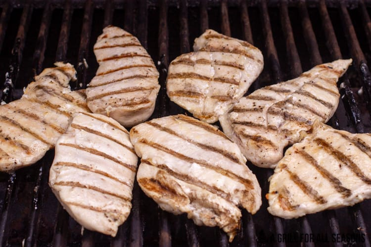 grilled chicken breasts on grill.