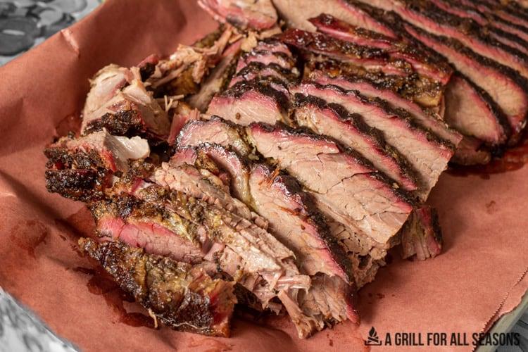 sliced smoked beef brisket on butcher paper