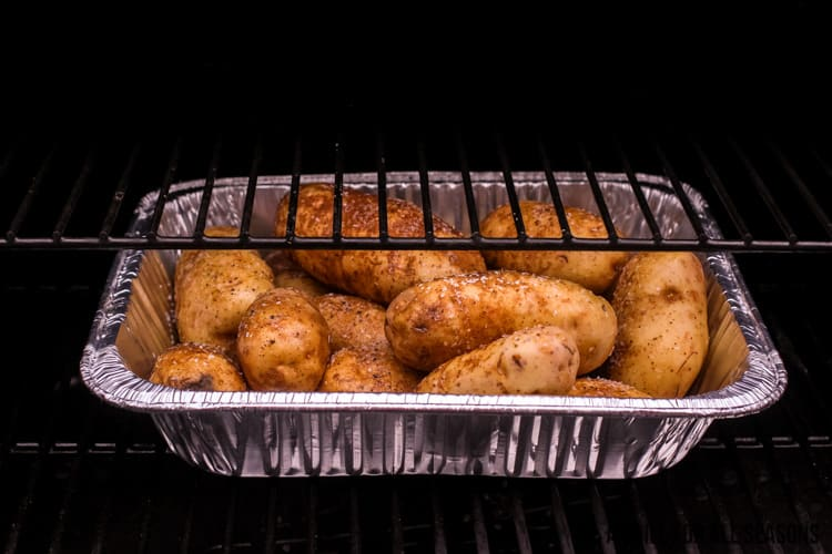 aluminum pan of spuds on the pellet grill