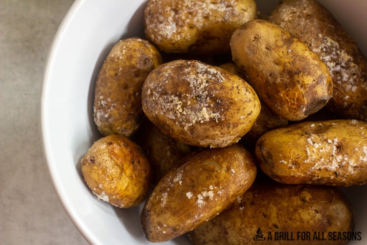 bowl of smoked baked potatoes with crispy skin